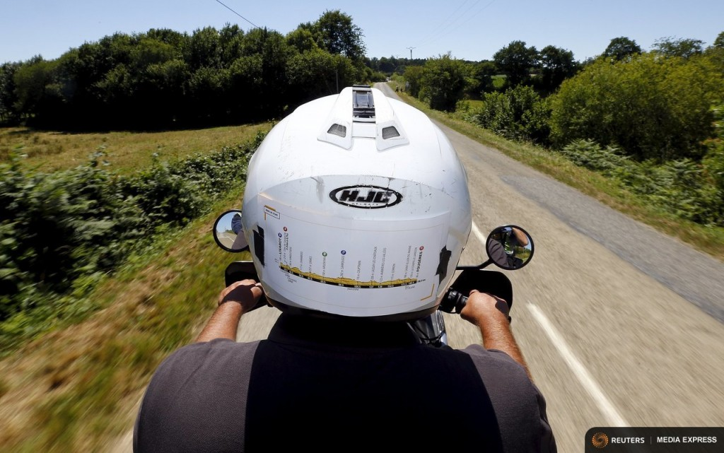 "The stage map is seen on the back of the helmet of the Reuters motorbike driver as he rides during the 7th stage of the 102nd Tour de France cycling race from Livarot to Fougeres, France, July 10, 2015. Photographing the Tour de France cycling race comes with highs and lows: the buzz from capturing just the right image, the tedium of long journeys, the painstaking set-up of equipment, the breath-taking scenery. Reuters photographers have worked not only to capture the thrills and spills on the roads and mountain passes. They have also shot a set of pictures showing their own quirky view from behind the scenes as they travelled through the Netherlands, Belgium and France. REUTERS/Stefano Rellandini TPX IMAGES OF THE DAY      PICTURE 2 OF 36 FOR WIDER IMAGE STORY ""ON THE SIDELINES - THE TOUR DE FRANCE""  SEARCH ""SIDELINES TOUR"" FOR ALL PICTURES"