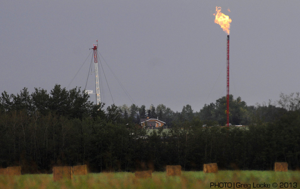 Gas flare from drill rig near a home in Hythe, Alberta, Photo by Greg Locke © 2009