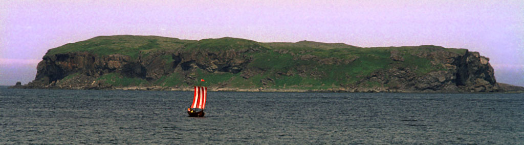 (000730-GSL06.jpg) L'ANSE AUX MEADOWS, NEWFOUNDLAND. 27JUL00 -- NEWFOUNDLAND VIKING FESTIVAL -- Peter Adrian, of Sweden, pilots his viking ship, the Thor Viking, in the waters around the Norstead viking encampment near the L'anse aux Meadows National Historic Site which is the only proven Norse settlement in North America and the site of a festival marking 1000 years since the settlement was founded by the Viking Leif Ericsson. Photo by GREG LOCKE. --COPYRIGHT (C) 2000. ONE TIME USE ONLY. NO ELECTRONIC ARCHIVING PERMITTED. NO THIRD PARTY DISTRIBUTION.