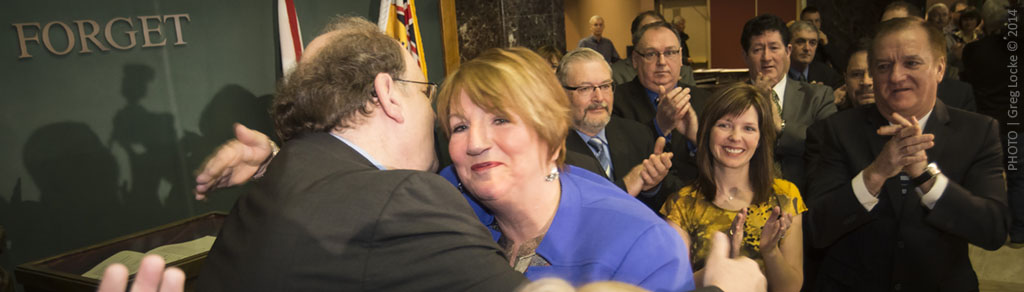 Newfoundland and Labrador Premier, Kathy Dunderdale hugs her finance minister and interime leader, Tom Marshall, after announcing her resignation in St. John's, Newfoundland today, Jan 22, 2014. Photo by Greg Locke © 2014