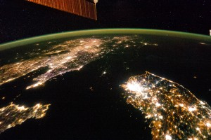 A photo of the Koreas at night taken from the International Space Station January 30, 2014. The image illustrates the stark difference between North and South Korea: North Korea is almost completely dark compared to neighboring South Korea and China. The darkened land appears as if it were a patch of water joining the Yellow Sea to the Sea of Japan. Photo courtesy of NASA.