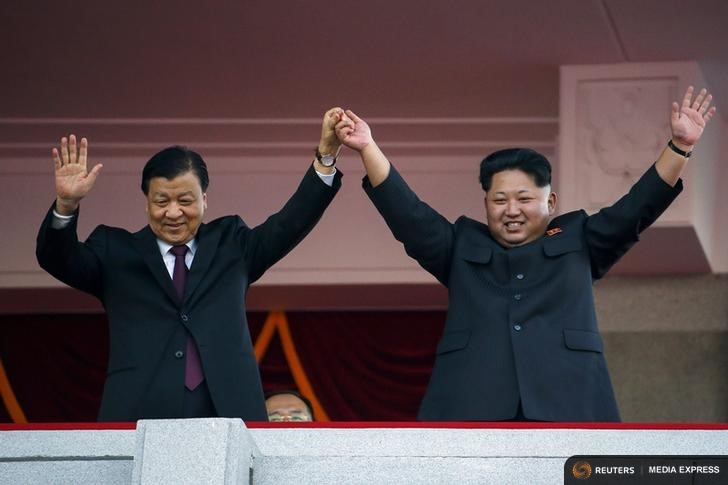 North Korean leader Kim Jong Un (R) and senior Chinese Communist Party official Liu Yunshan wave to the crowd during the parade celebrating the 70th anniversary of the founding of the ruling Workers' Party of Korea, in Pyongyang October 10, 2015. Isolated North Korea marked the 70th anniversary of its ruling Workers' Party on Saturday with a massive military parade overseen by leader Kim Jong Un, who said his country was ready to fight any war waged by the United States. REUTERS/Damir Sagolj TPX IMAGES OF THE DAY