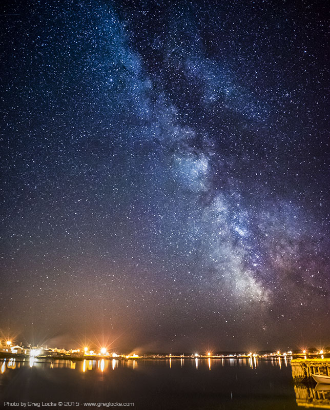 The Milky Way rises in the southern sky over the remote fishing village of Joe Batt's Arm in the small hours of a summer night  on Fogo Island off the north east coast of Newfoundland in the north west Atlantic ocean.  Photo by Greg locke © 2015 - www.greglocke.com