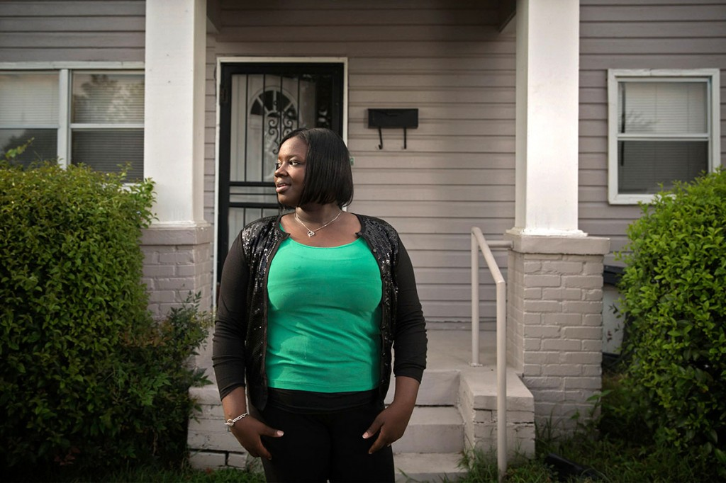 Evonna Lucas stands for a portrait outside of her home on in south Greenwood. Lucas graduated from Mississippi Valley State University last year, but said that well-paying jobs for educated young people are hard to find in her hometown. Photo by Edmund D. Fountain, special to ProPublica. © 2014