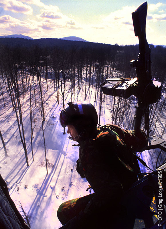 A British army helicopter serving with IFOR searches for mass graves near the town of Srebrenica, Bosnia in the winter of 1996. Photo by Greg Locke © 1996 Copyright.