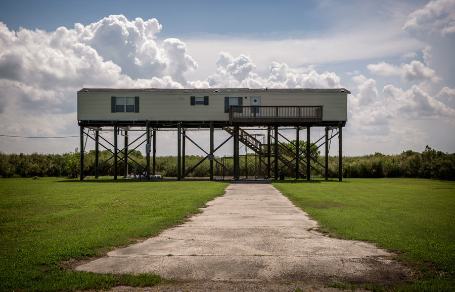 Because subsidence and wetlands loss now allows the the surge from even small storms now covering the area, new homes like this are built on stilts high above the ground. Photo by Edmund D. Fountain/ProPublica/The Lens