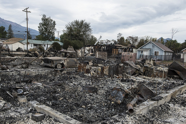 Weed, California. Fire burned 100 homes September 15, 2014 in the Siskiyou County town of Weed. The state, experiencing record drought, declared an emergency in January. Photo by California Emergency Services.