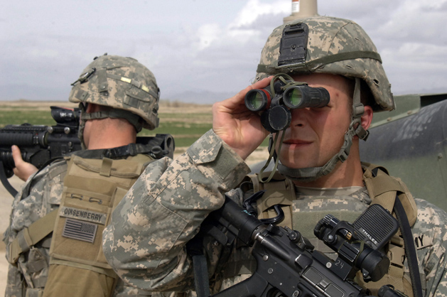 Mir-e, Afghanistan -- United States Army Sgt. Joseph Evans scans the area through while Spc. Brendon Quisenberry pulls rear security during a route reconnaissance mission near Mir-e, Afghanistan, April 4, 2007. Photo by U.S. Army Staff Sgt. Michael L. Casteel, Public Domain