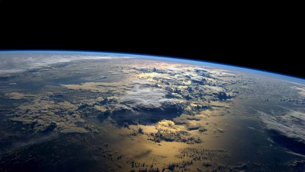 Earth at dawn from the International Space Station. Photo by Reid Wiseman, NASA, public domain