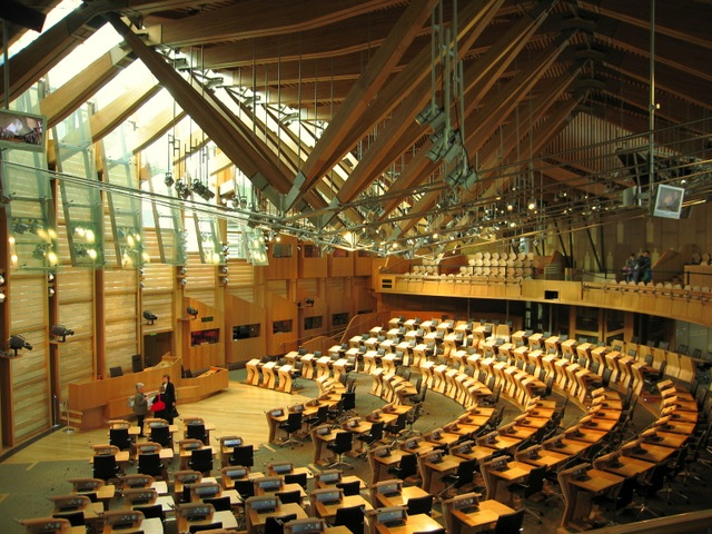 The main chamber of the Scottish Parliament. Photo by Martyn Gorman, geograph.org.uk, Creative Commons