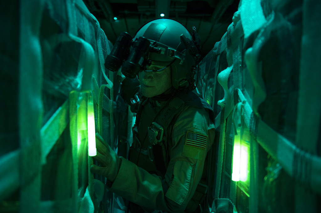 Master Sgt. Pennie J. Brawley of the U.S. Air Force prepares to drop water bottles and halal meals from a C-130 Hercules, to people stranded by IS in Sinjar, Iraq. Photo by Staff Sgt. Vernon Young Jr., public domain