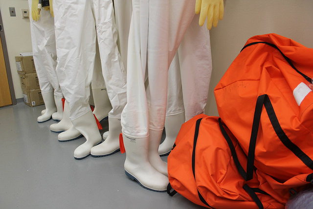 Hazmat gear for Ebola response at the Level 4 BioSafety Lab at the Texas BioMed Research Institute. Photo by David Martin Davies via Flickr, Creative Commons