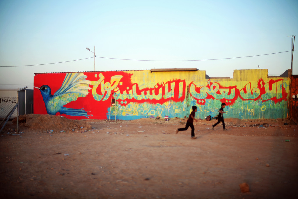 "Refugees from the war in Syria continue to arrive to the Kurdistan region of Iraq. Despite the seemingly impossible situation, children created a mural that reads, ""hope gives wings to humanity."" Photo by Samantha Robinson, European Commission, public domain"