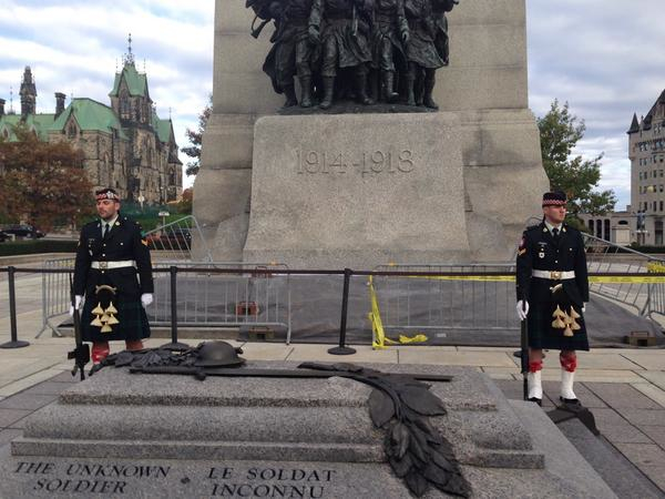 OTTAWA, Oct. 22, 2014 -- Cpl. Nathan Cirillo and fellow reservist Brandon Stevenson stand guard at the War Memorial in Ottawa, moments before a shooter killed Cpl. Cirillo. Photo © Evanem on Twitter @kamakazi19982, with permission