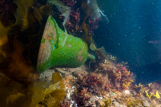 "The ""broad arrow"" is visible on the bell of HMS Erebus. Photo by Thierry Boyer, © Parks Canada"