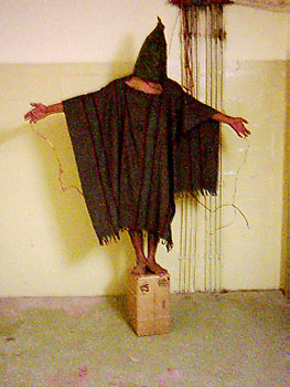 Iconic image of Ali Shallal al-Qaisi being tortured in Abu Ghraib prison, Iraq