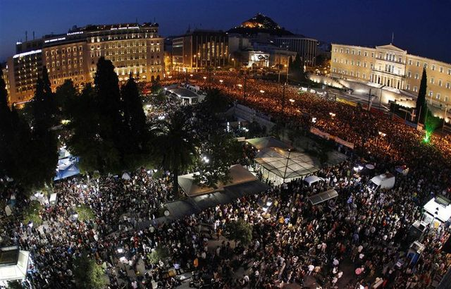 Some 100,000 anti-austerity protesters demonstrate in front of the Greek parliament in 2011. Photo by Kotsolis via Wikipedia, Creatiive Commons