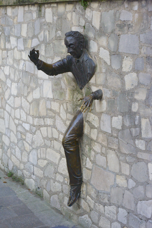 A statute in Montmartre, Paris, celebrates French author Marcel Aymé, whose character Dutilleul, in Le Passe-Muraille, could walk through walls. Photo by Deborah Jones © 2015