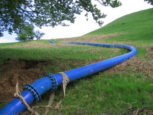 Water pipe in Brisbane Glen, U.K. via Wikimedia
