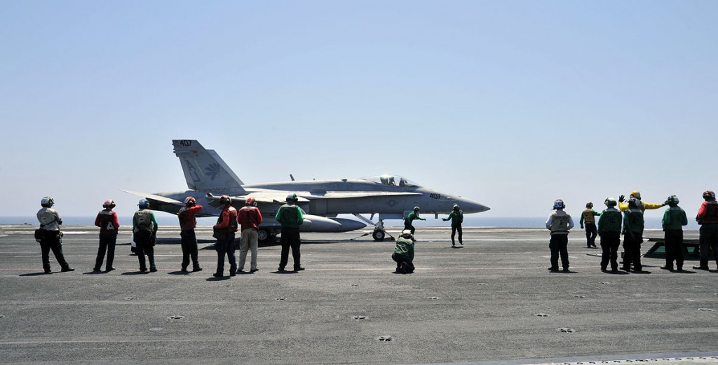 America led the latest intervention in Iraq, starting in January, 2014. Above, U.S. Navy sailors with a F/A-18C Hornet, aboard the aircraft carrier USS George H.W. Bush. U.S. Navy photo by Mass Communication Specialist 3rd Class Margaret Keith