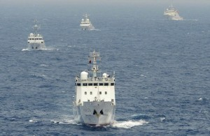 Chinese surveillance ships sail in formation in waters claimed by Japan near disputed islands called Senkaku in Japan and Diaoyu in China in the East China Sea, in April, 2013. Photo by Times Asi, Creative Commons
