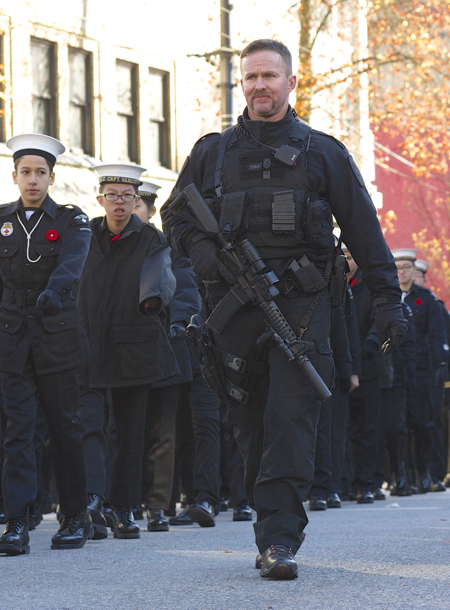 "Canadian Prime Minister Stephen Harper introduced a draconian bill, C-51, skillfully exploiting ""security psychosis"" to help win the next election. Above, last fall heavily armed police were called in to accompany Canadian Remembrance Day marchers. © Deborah Jones, 2014"