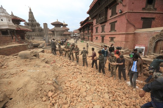 The United Nations and Nepal government are among agencies appealing for relief funds. Above, people in the Katmandu Valley form a line to move debris and reach trapped survivors. Photo: Laxmi Prasad Ngakhusi/UNDP