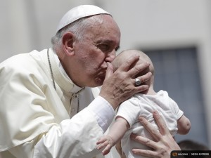 Pope Francis kisses a baby as he leaves at the end of his Wednesday general audience in Saint Peter's square at the Vatican June 17, 2015. REUTERS/Max Rossi -