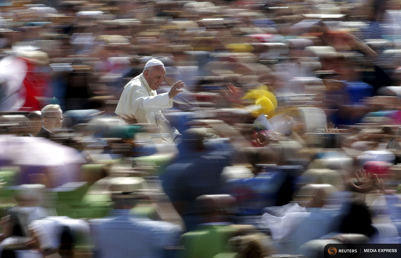Pope Francis waves as he arrives to lead his Wednesday general audience in Saint Peter's square at the Vatican June 17, 2015. REUTERS/Max Rossi