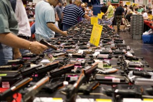 The NRA's primary goal is not to serve its members, but to ensure the gun manufacturers that sponsor and fund it make as much money as possible, writes Tom Regan. Above, the wares at a gun show in Houston, Texas. Photo by M&R Glasgow via Flickr, Creative Commons