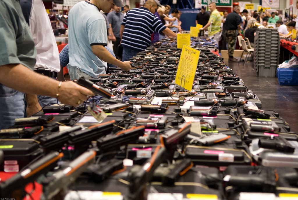 Above, the wares at a gun show in Houston, Texas. Photo by M&R Glasgow via Flickr, Creative Commons