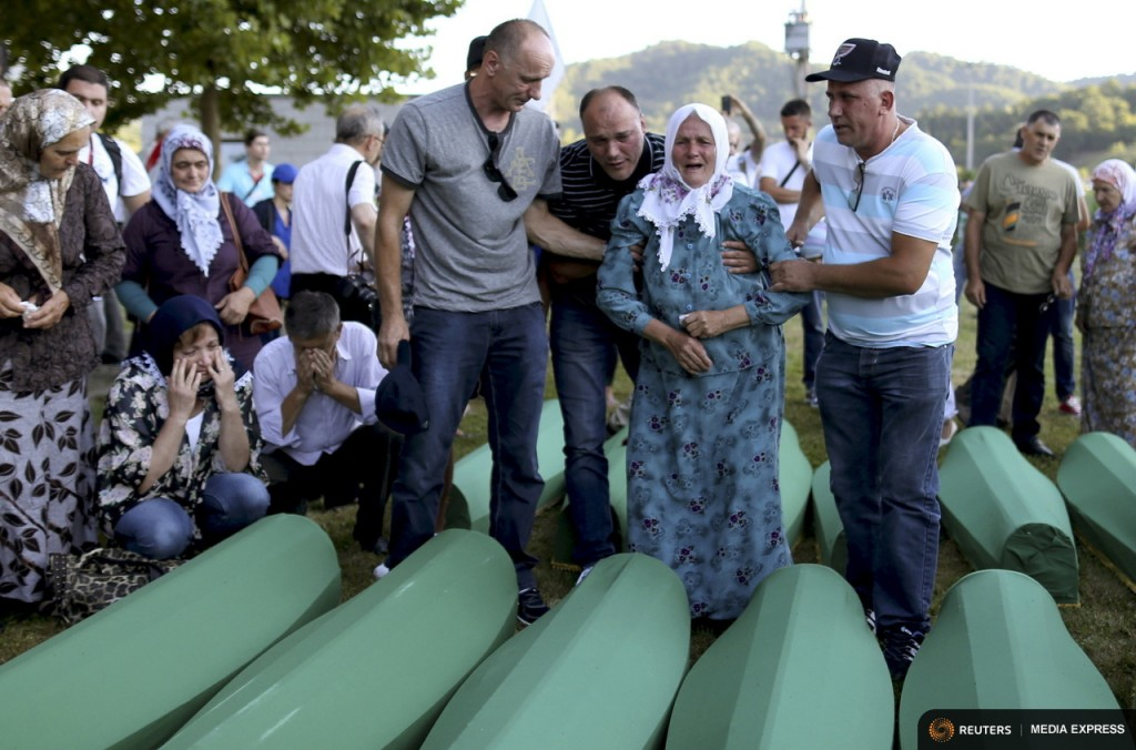 A woman cries near coffin of her relatives who were victims of the 1995 Srebrenica massacre, at the Memorial Centre in Potocari, Bosnia and Herzegovina July 10, 2015.  REUTERS/Dado Ruvic