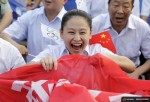 Local resident Zhang Jing celebrates after Beijing was chosen to host the 2022 Winter Olympics at a square in Chongli county of Zhangjiakou, jointly bidding to host the 2022 Winter Olympic Games with capital Beijing, July 31, 2015. REUTERS/Jason Lee