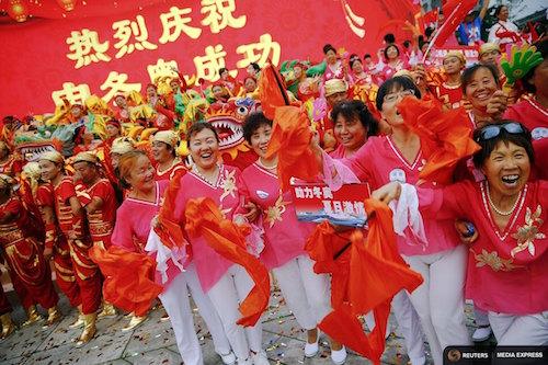 People celebrate after Beijing was chosen to host the 2022 Winter Olympics in front of Bird's Nest Olympic stadium in Beijing July 31, 2015.  REUTERS/Damir Sagolj