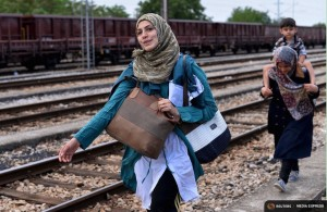 Migrants arrive from Greece at the train station in Gevgelija near the Greek border with Macedonia July 30, 2015. Tens of thousands of migrants, mainly from the Middle East and Africa, use the Balkans route to get into the European Union, passing from Greece to Macedonia and Serbia and then to western Europe. After walking across the border into Macedonia to the small local station of Gevgelia, migrants pile onto an overcrowded four-carriage train in sweltering heat, young infants among them, to travel about 200 km north. Their aim: to enter Serbia on foot, another step in their uncertain search for a better life. REUTERS/Ognen Teofilovski