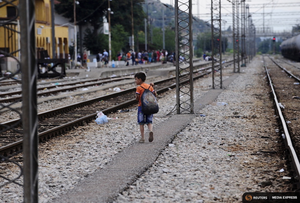A boy walks through Gevgelija train station near the Greek border with Macedonia July 30, 2015. Tens of thousands of migrants, mainly from the Middle East and Africa, use the Balkans route to get into the European Union, passing from Greece to Macedonia and Serbia and then to western Europe. After walking across the border into Macedonia to the small local station of Gevgelia, migrants pile onto an overcrowded four-carriage train in sweltering heat, young infants among them, to travel about 200 km north. Their aim: to enter Serbia on foot, another step in their uncertain search for a better life. REUTERS/Ognen Teofilovski