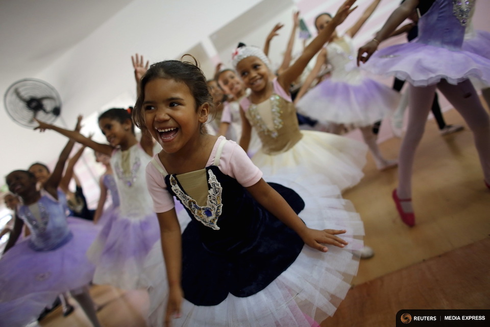 "Young girls take ballet lessons at the New Dreams dance studio in the Luz neighborhood known to locals as Cracolandia (Crackland) in Sao Paulo, Brazil, August 14, 2015. For the young girls learning to jump and plie, the dance studio provides a way forward and out of the difficult environment they have grown up in. Brazil is one of the world's highest consuming countries of crack cocaine, and Cracolandia, or ""Crack Land"", located in the outskirts of Sao Paulo, is one of the most intense and brutal hubs. Picture taken August 14, 2015. REUTERS/Nacho Doce"