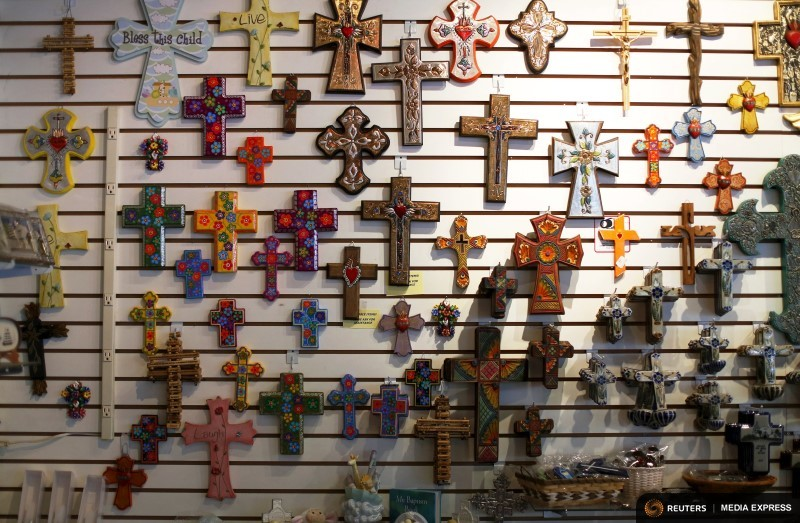 "Decorative crucifixes are displayed at the gift shop at Mission San Diego de Alcala in San Diego, California, September 14, 2015. Pope Francis will declare Friar Junipero Serra a saint at a Mass celebrated at the National Shrine in Washington on September 23 during the pontiff's first visit to the United States. The Franciscan friar from Spain built a series of missions along the Pacific coast in the 18th century, in what is now California, to spread the faith among Native Americans. His advocates say he supported the Indians, introducing cattle and crops to their land. The Vatican has defended Serra against accusations that, as part of the Spanish colonial system, he suppressed Native Americans. Serra's resting place is inside the Basilica at the Carmel Mission south of San Francisco. REUTERS/Mike Blake PICTURE 24 OF 35 FOR WIDER IMAGE STORY ""POPE TO CANONISE FRIAR SERRA"". SEARCH ""SERRA NATIVE"" FOR ALL IMAGES"