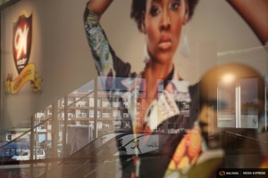 "A reflection is seen in the window of a Woodin clothing store at the newly expanded Cap Sud mall in Abidjan, Ivory Coast, September 14, 2015. From Abidjan's packed airport arrivals hall to the buildings mushrooming across the capital, Ivory Coast is booming, a rare African bright spot as the world's biggest cocoa producer bounces back from a 2011 civil war. Buyers of luxury apartments include Ivorians living overseas, while promoters from Morocco, Turkey and China are attracted by tax breaks. Elections - the source of national unrest four years ago - are due in a month but there is no let-up in investment given expectations of an easy victory for incumbent Alassane Ouattara. The government predicts 9.6 percent growth this year, making the former French colony the standout performer on a continent hammered by a slump in commodity prices, capital outflows and tumbling currencies. REUTERS/Joe PenneyPICTURE 22 OF 33 FOR WIDER IMAGE STORY ""IVORY COAST IS BOOMING"". SEARCH ""BOOMING PENNEY"" FOR ALL IMAGES"
