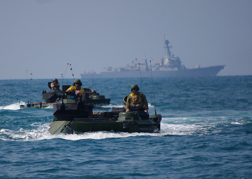 Amphibious assault vehicles and USS Denver  participate in an exercise in the South China Sea, 2011.  U.S. government photo via Wikimedia