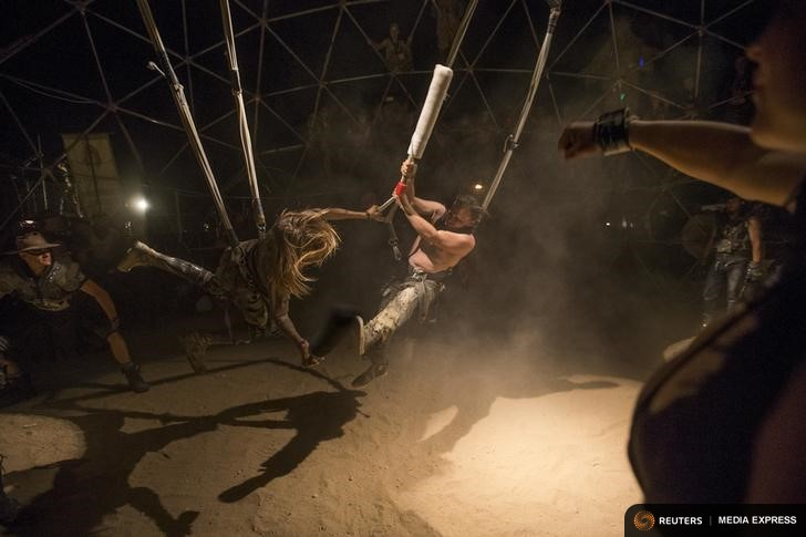 Enthusiasts fight at the Thunderdome during Wasteland Weekend event in California City, California September 26, 2015. The four-day event has a post-apocalyptic theme and is inspired by the Mad Max movie franchise. Picture taken September 26, 2015. REUTERS/Mario Anzuoni