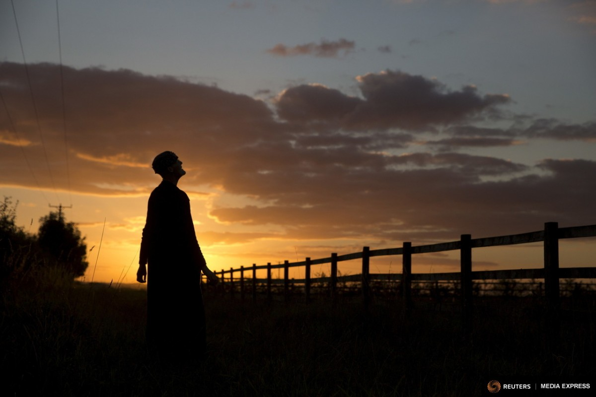 "Sister Rachel Denton views the sunset from a vantage point near St Cuthbert's Hermitage in Lincolnshire, north east Britain September 25, 2015. Denton, a Catholic hermit, rises early to tend to her vegetable garden, feed her cats and pray. But the former Carmelite nun, who in 2006 pledged to live the rest of her life in solitude, has another chore - to update her Twitter account and check Facebook. ""The myth you often face as a hermit is that you should have a beard and live in a cave. None of which is me,"" says the ex-teacher. For the modern-day hermit, she says social media is vital: ""tweets are rare, but precious,"" she writes on her Twitter profile. The internet also allows Denton to shop online and communicate with friends. ""I am a hermit but I am also human."" A diagnosis of cancer earlier this year reaffirmed Denton's wish to carry on a life of solitude, prayer and contemplation. REUTERS/Neil Hall"