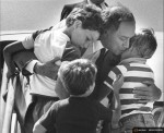 Canada's Prime Minister Pierre Trudeau greets his sons Justin (L), Sacha (R) and Michel after returning home from a foreign trip in Ottawa, in a 1983 file photo. Canada's new prime minister, Justin Trudeau, is moving back to the house where he grew up. The Liberal leader, son of former prime minister Pierre Trudeau, led his party to victory in a federal election on Monday, defeating Stephen Harper's Conservatives by a wide margin. REUTERS/Andy Clark
