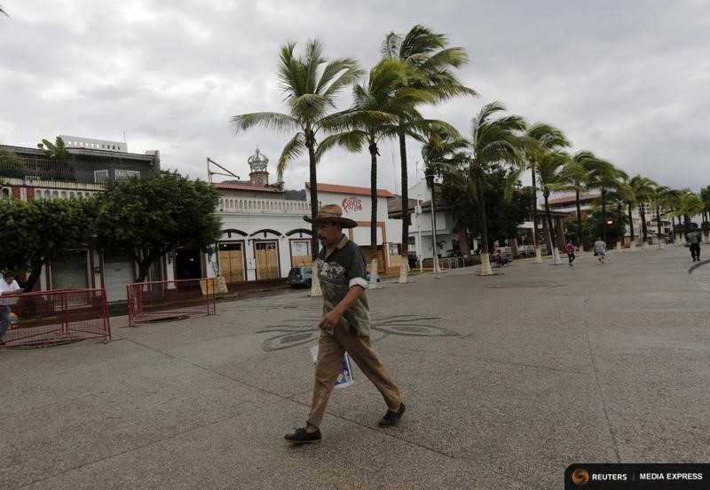 A man walks along the city's historic boardwalk in the Pacific beach resort of Puerto Vallarta, Mexico October 24, 2015. REUTERS/Henry Romero