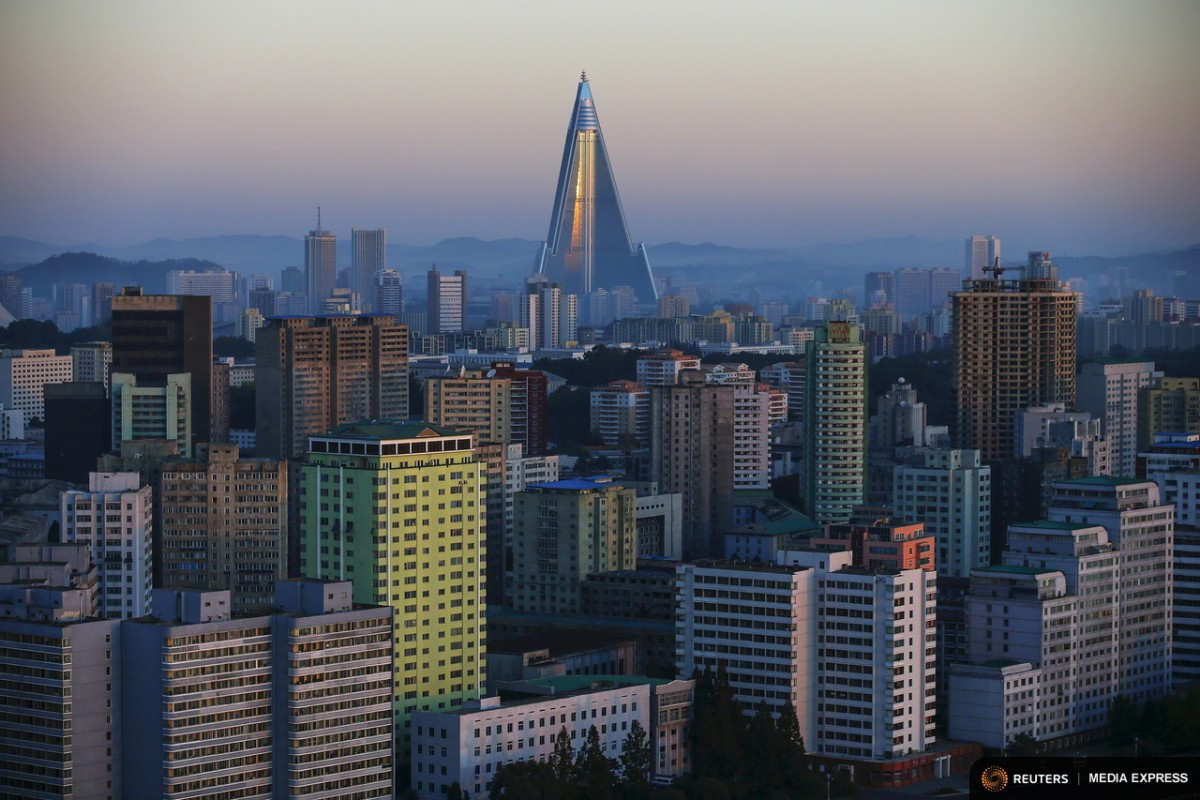 The 105-storey Ryugyong Hotel, the highest building under construction in North Korea, is seen behind residential buildings in Pyongyang, North Korea, early October 9, 2015. North Korea is getting ready to celebrate the 70th anniversary of the founding of its ruling Workers' Party of Korea on October 10.  REUTERS/Damir Sagolj REUTERS/Damir Sagolj      TPX IMAGES OF THE DAY