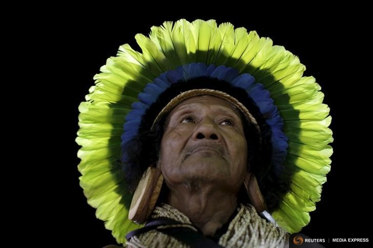 An indigenous man from the Rikbaktsa tribe watches a tug-of-war competition at the first World Games for Indigenous Peoples in Palmas, Brazil, October 29, 2015. REUTERS/Ueslei Marcelino