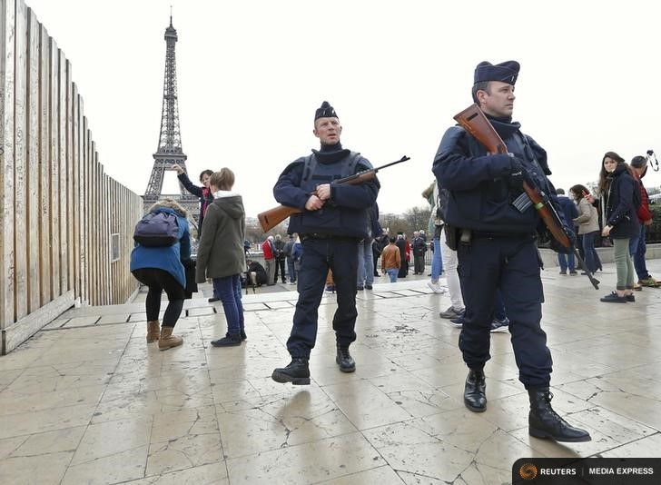 Police patrol near the Eiffel Tower the day after a series of deadly attacks in Paris , November 14, 2015. REUTERS/Yves Herman