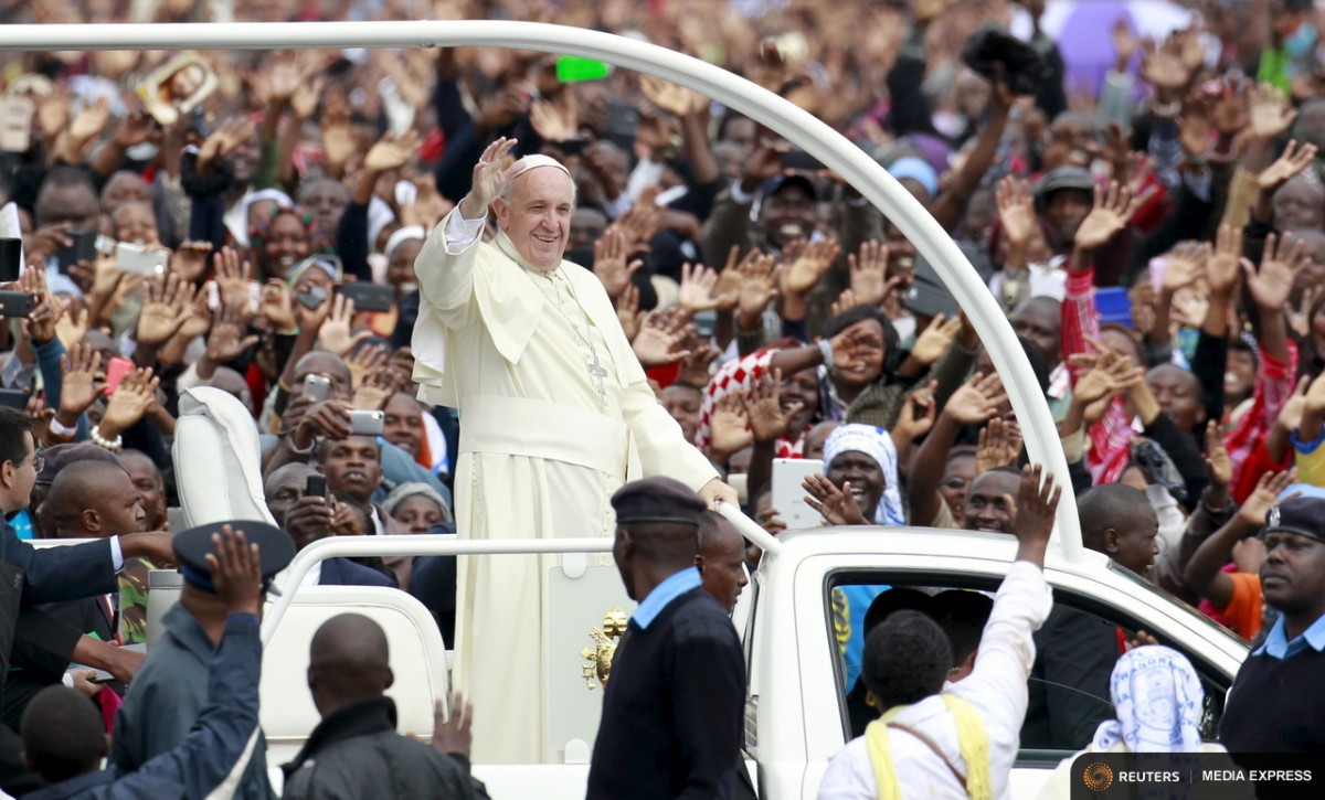 Pope Francis waves to the faithful as he arrives for a Papal mass in Kenya's capital Nairobi, November 26, 2015. REUTERS/Thomas Mukoya