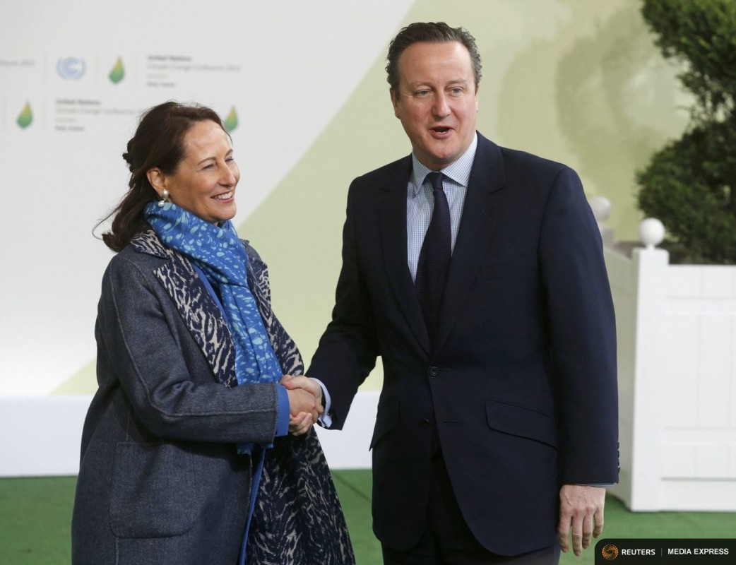 French Ecology Minister Segolene Royal (L) welcomes Britain's Prime Minister David Cameron as he arrives for the opening day of the World Climate Change Conference 2015 (COP21) at Le Bourget, near Paris, France, November 30, 2015. REUTERS/Christian Hartmann
