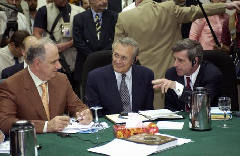 Ahmed Chalabi in discussion with Paul Bremer and Donald Rumsfeld. Photo by MSgt. James Bowman